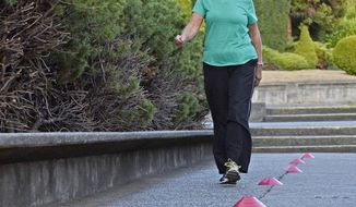 Recovering cancer patient Lynn Laurel does a six minute walk Thursday, Sept. 13, 2017, during her Skagit Valley YMCA LIVESTRONG at the YMCA class. Before her cancer, Lynn Laurel walked 4 miles every day. Now, about a year after her diagnosis, Laurel is working hard to find her way back to a healthy lifestyle.  The program, LIVESTRONG at the YMCA, is offered at 211 YMCAs in 39 states and has served about 41,000 cancer patients, according to a YMCA fact sheet. The free program is targeted for people who are or have been in treatment for cancer. (Scott Terrell /Skagit Valley Herald via AP)