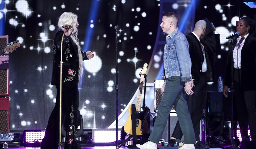 Kesha, left, and Macklemore perform at the 2017 iHeartRadio Music Festival Day 2 held at T-Mobile Arena on Saturday, Sept. 23, 2017, in Las Vegas. (Photo by John Salangsang/Invision/AP)
