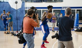 Photographers photograph Philadelphia 76ers' Joel Embiid as he dribbles a ball during media day at the NBA basketball team's practice facility, Monday, Sept. 25, 2017, in Camden, N.J. (AP Photo/Matt Rourke)