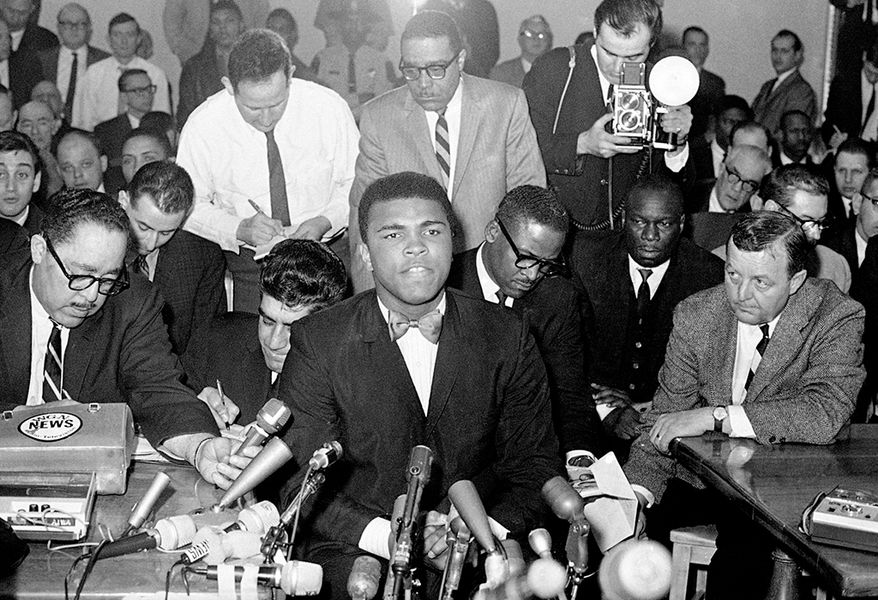 In 1966, two years after winning the heavyweight title, Muhammad Ali refused to be drafted into the U.S. military, citing his religious beliefs and opposition to American involvement in the Vietnam War. He found guilty of draft evasion charges, and stripped of his boxing titles. Ali's actions as a conscientious objector to the war made him an icon for the larger counterculture generation. (AP Photo)