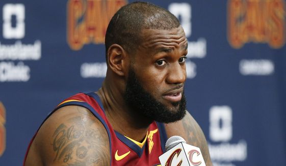 Cleveland Cavaliers' LeBron James answers questions during the NBA basketball team media day, Monday, Sept. 25, 2017, in Independence, Ohio. (AP Photo/Ron Schwane)