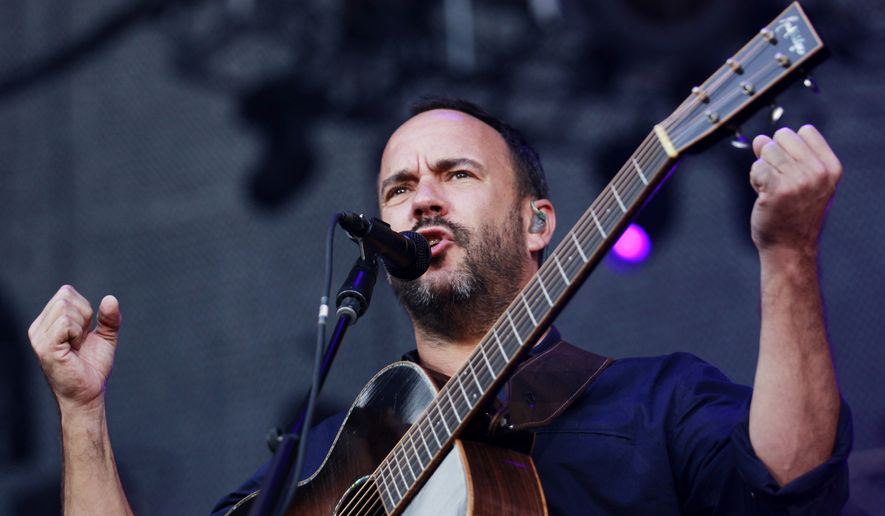 Dave Matthews delivers a speech at the start of the show after performing a solo song Sunday, Sept. 24, 2017, in Charlottesville, Va. Thousands of people have packed a stadium for a concert intended to raise money for charity and promote unity in the aftermath of this summer's white nationalist rallies. Matthews, whose band got its start in the Virginia college town, hosted the Sunday show. (Zack Wajsgras/The Daily Progress/The Daily Progress via AP)