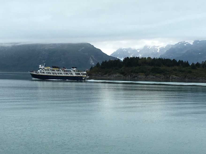 A vessel cruises in Glacier Bay National Park in Alaska.  (Eric Althoff/The Washington Times)