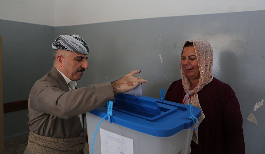 An Iraqi Kurdish man casts his ballot during the referendum on independence from Iraq in Irbil, Iraq, Monday, Sept. 25, 2017. Iraq's Kurdish region vote in a referendum on whether to secede from Iraq. (AP Photo/Khalid Mohammed)