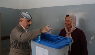 An Iraqi Kurdish man casts his ballot during the referendum on independence from Iraq in Irbil, Iraq, Monday, Sept. 25, 2017. Iraq's Kurdish region vote in a referendum on whether to secede from Iraq. (AP Photo/Khalid Mohammed)