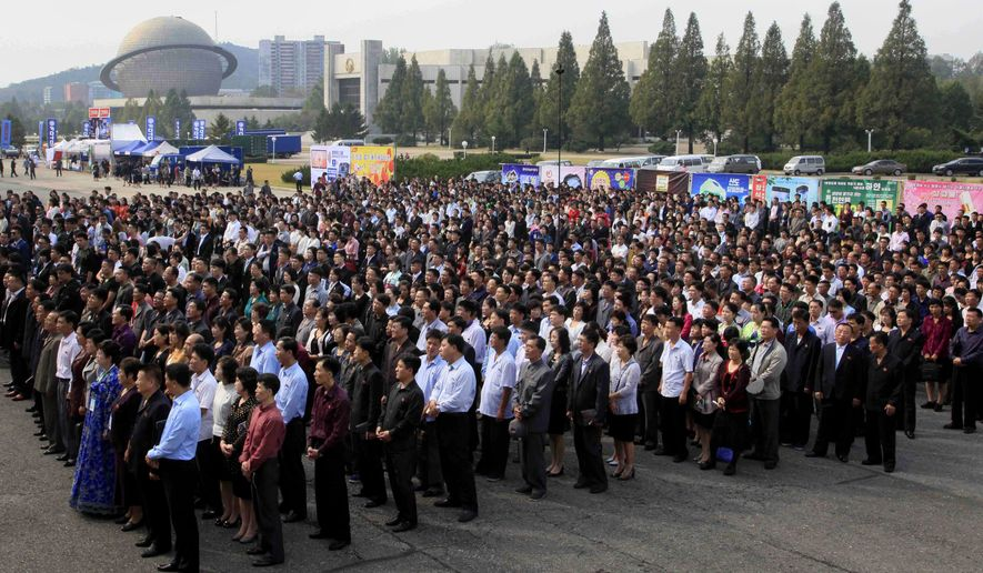North Koreans attend an opening ceremony of the 13th Pyongyang Autumn International Trade Fair held at the Three Revolution Exhibition House on Monday, Sept. 25, 2017, in Pyongyang, North Korea. (AP Photo/Kim Kwang Hyon)