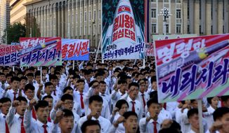 "Hundreds of thousands of North Koreans gathered at Kim Il Sung Square to attend a mass rally against America on Saturday Sept. 23, 2017, in Pyongyang, North Korea, a day after the country's leader issued a rare statement attacking Donald Trump. Seen on the sign with the painting of a rocket in the center are Korean words which read ""defend until the death, single hearted unity"" and below it in blue ""the American imperialists should see clearly the power of our country"", the sign in the foreground right reads ""please give us the order."" (AP Photo/Jon Chol Jin)"