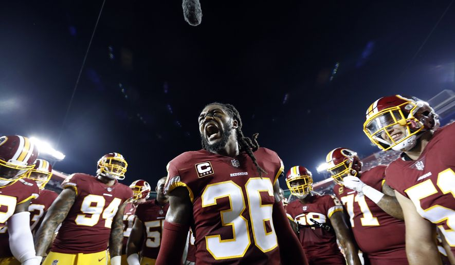 Washington Redskins free safety D.J. Swearinger (36) motivates his team in the huddle before an NFL football game against the Oakland Raiders, Sunday, Sept. 24, 2017, in Landover, Md. (AP Photo/Alex Brandon)