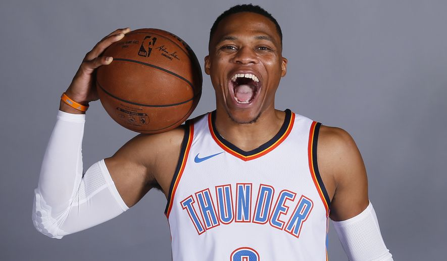 Oklahoma City Thunder guard Russell Westbrook lets out a roar during an NBA basketball media day in Oklahoma City, Monday, Sept. 25, 2017. (AP Photo/Sue Ogrocki)
