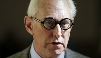 In this March 30, 2017, file photo, Roger Stone talks to reporters outside a courtroom in New York. (AP Photo/Seth Wenig, File)