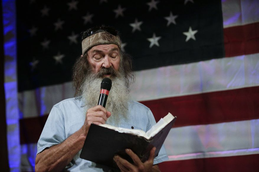 Phil Robertson of Duck Dynasty speaks at a rally for U.S. Senate hopeful Roy Moore, Monday, Sept. 25, 2017, in Fairhope, Ala. (AP Photo/Brynn Anderson)