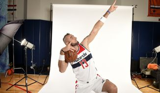 Washington Wizards' Marcin Gortat, of Poland, poses for a photograph during an NBA basketball media day, Monday, Sept. 25, 2017, in Washington. (AP Photo/Nick Wass)