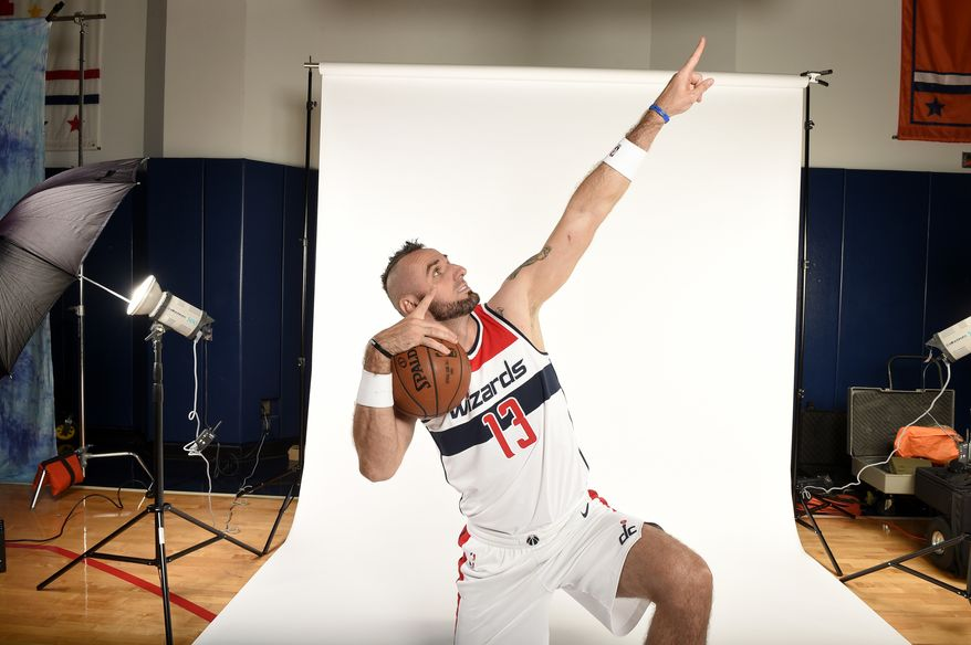 Washington Wizards' Marcin Gortat, of Poland, poses for a photograph during an NBA basketball media day, Monday, Sept. 25, 2017, in Washington. (AP Photo/Nick Wass)