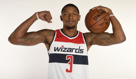 Washington Wizards' Bradley Beal poses for a photograph during an NBA basketball media day, Monday, Sept. 25, 2017, in Washington. (AP Photo/Nick Wass)