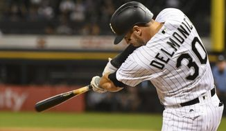 Chicago White Sox's Nicky Delmonico (30) hits a two-run double against the Los Angeles Angels during the first inning of a baseball game in Chicago on Monday, Sept. 25, 2017. (AP Photo/Matt Marton)