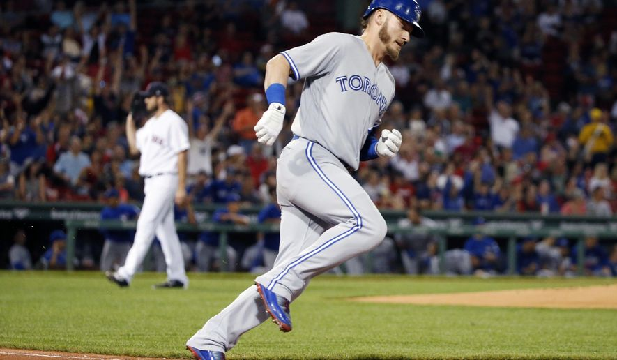 Toronto Blue Jays' Josh Donaldson rounds first base on his solo home run off Boston Red Sox's Drew Pomeranz, left, during the first inning of a baseball game in Boston, Monday, Sept. 25, 2017. (AP Photo/Michael Dwyer)