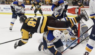 Pittsburgh Penguins' Sidney Crosby (87) is upended by St. Louis Blues' Paul Stastny as he tries to get to the puck in the go rease during the third period of the NHL preseason hockey game, Sunday, Sept. 24, 2017, in Cranberry, Pa. The Blues won 4-1. The preseason game was awarded to Rostraver Ice Garden, the winner of the 2016-2017 Kraft Hockeyville USA contest, but is being played at the UPMC Lemieux Sports Complex because Rostraver is not suitable for an NHL game. (AP Photo/Keith Srakocic)