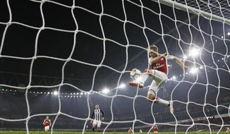 Arsenal's Nacho Monreal clears the ball off the line during their English Premier League soccer match between Arsenal and West Bromwich Albion at the Emirates stadium in London, Monday, Sept. 25, 2017. (AP Photo/Alastair Grant)