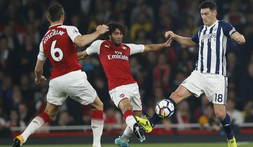 West Bromwich Albion's Gareth Barry, right, in action with Arsenal's Mohamed Elnenar, centre, during their English Premier League soccer match between Arsenal and West Bromwich Albion at the Emirates stadium in London Monday, Sept. 25, 2017. (AP Photo/Alastair Grant)