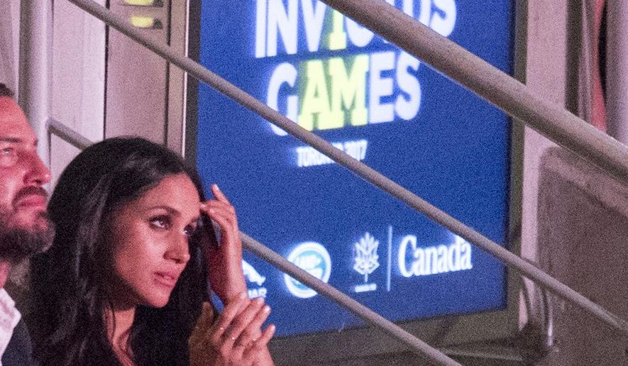 Meghan Markle attends the Invictus Games Opening Ceremonies in Toronto on Saturday, Sept. 23, 2017, a few rows apart from her boyfriend, Britain's Prince Harry. Markle lives in Toronto, but hadn't appeared with Harry since he arrived in the city. (Frank Gunn /The Canadian Press via AP)