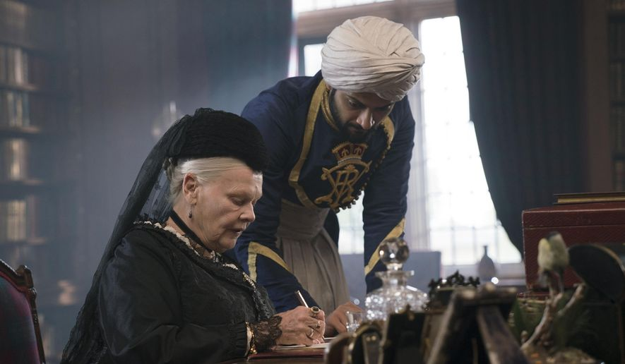 """In this image released by Focus Features, Judi Dench, left, and Ali Fazal appear in a scene from """"Victoria and Abdul."""" (Peter Mountain/Focus Features via AP)"""