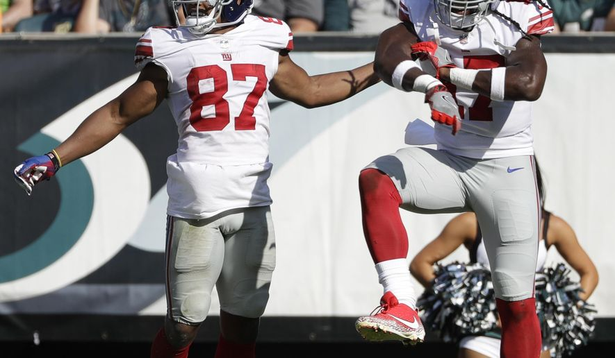 New York Giants' Sterling Shepard, left, and Dwayne Harris celebrate after Shepard's touchdown during the second half of an NFL football game against the Philadelphia Eagles, Sunday, Sept. 24, 2017, in Philadelphia. (AP Photo/Michael Perez)