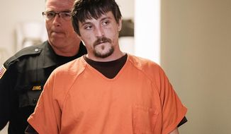 FILE - In this April 25, 2017, file photo, Joseph Jakubowski is escorted into a room at the Rock County Courthouse for his preliminary hearing in Janesville, Wis. Jakubowski, who is accused of stealing an arsenal of firearms from a southern Wisconsin gun shop and sending an anti-government manifesto to President Donald Trump, is set to go on trial in federal court in Madison beginning Monday, Sept. 25, 2017. (Angela Major/The Janesville Gazette via AP, File)