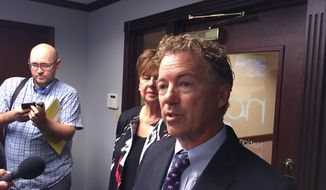 Kentucky Republican U.S. Sen Rand Paul tells reporters he plans to vote against a GOP bill that would repeal and replace most of former President Barack Obama's health care law on Monday, Sept. 25, 2017, in Louisville, Ky. (AP Photo/Adam Beam)