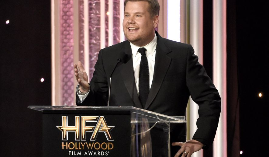 FILE - In this Nov. 6, 2016, file photo, host James Corden speaks at the 20th annual Hollywood Film Awards at the Beverly Hilton Hotel in Beverly Hills, Calif. Dick Clark Productions announced on Sept. 25, 2017, that Corden will return to host a third straight year when the awards are handed out on Nov. 5, 2017. (Photo by Chris Pizzello/Invision/AP, File)