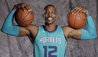 Charlotte Hornets' Dwight Howard poses for a photo during the NBA basketball team's media day in Charlotte, N.C., Monday, Sept. 25, 2017. The Hornets are banking on Dwight Howard to help them get back to the playoffs after a disappointing season a year ago. (AP Photo/Chuck Burton)