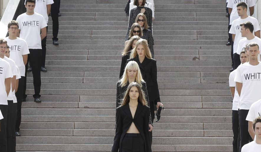 Models wear creations part of the SSheena women's Spring-Summer 2018 collection, that was presented in front of the Duomo gothic cathedral, in Milan, Italy, Monday, Sept. 25, 2017. (AP Photo/Luca Bruno).