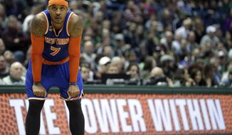 FILE - In this March 8 2017, file photo, New York Knicks' Carmelo Anthony watches a free throw during the second half of an NBA basketball game against the Milwaukee Bucks in Milwaukee. The Knicks agreed to trade Anthony to the Thunder on Saturday, Sept. 23, 2017, saving themselves a potentially awkward reunion next week with the player they'd been trying to deal since last season.  New York will get Enes Kanter, Doug McDermott and a draft pick, a person with knowledge of the deal said. The person spoke with The Associated Press on condition of anonymity because the trade had not been announced.  (AP Photo/Aaron Gash, File)