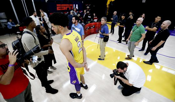 Los Angeles Lakers guard Lonzo Ball waits to be interviewed during an NBA basketball media day at the UCLA Health Training Center in El Segundo, Calif., Monday, Sept. 25, 2017. (AP Photo/Chris Carlson)