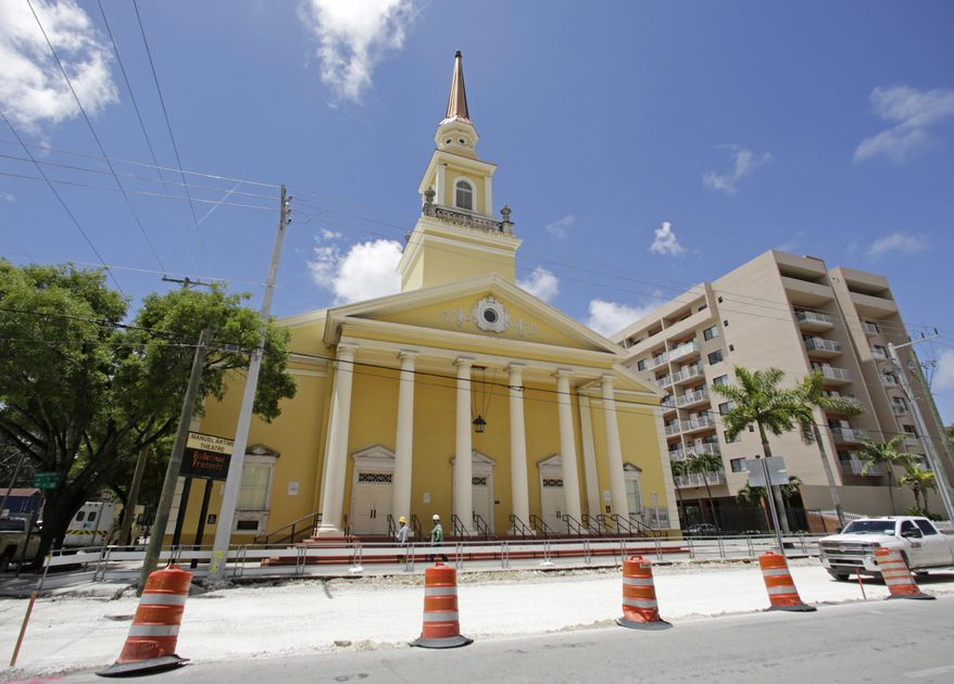 FILE - In this June 15, 2017, file photo, The Manuel Artime Theater, named after one of the late leaders of the Brigade 2506 Bay of Pigs veterans, is shown in the Little Havana area of Miami. The theater is one of 25 projects nationwide vying for funding from Partners in Preservation: Main Streets. The city of Miami is seeking funds from the Main Streets program to renovate and paint the theater's exterior. The public can vote on their favorite projects beginning Sept. 25, 2017, at VoteYourMainStreet.org. (AP Photo/Alan Diaz, File)
