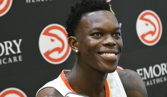 Guard Dennis Schroder of Germany takes questions during the Atlanta Hawks basketball media day, Monday, Sept. 25, 2017, in Atlanta. (AP Photo/John Amis)