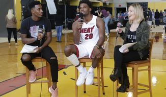 Miami Heat's Justise Winslow (20) is interviewed by Terek Pierce, left, and Megan Inglis, right, of HEAT Mobile App during Media Day, Monday, Sept. 25, 2017, in Miami. (AP Photo/Alan Diaz)