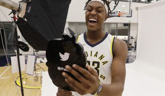 Indiana Pacers' Myles Turner poses for photos during the NBA basketball team media day, Monday, Sept. 25, 2017, in Indianapolis. (AP Photo/Darron Cummings)