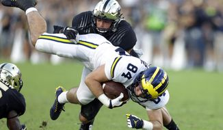 Michigan tight end Sean McKeon (84) is tackled by Purdue linebacker Markus Bailey (21) during the second half of an NCAA college football game in West Lafayette, Ind., Saturday, Sept. 23, 2017. Michigan defeated Purdue 28-10. (AP Photo/Michael Conroy)