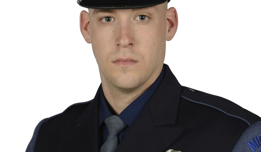 This undated photo provided by the Michigan State Police shows Trooper Timothy O'Neill. Michigan State Police said that O'Neill died from his injuries after crashing his motorcycle in the western part of the state Wednesday, Sept. 20, 2017. The three-year veteran was on patrol when the crash occurred near Rockford, about 12 miles north of Grand Rapids. Mich. (Michigan State Police via AP)