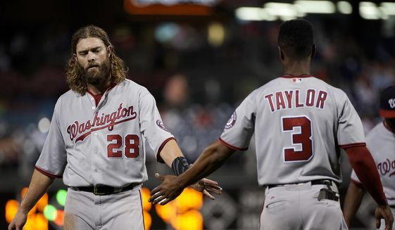 Washington Nationals' Jayson Werth, left, and Michael Taylor celebrate after the top of the eighth inning of a baseball game against the Philadelphia Phillies, Monday, Sept. 25, 2017, in Philadelphia. Washington won 3-1. (AP Photo/Matt Slocum)