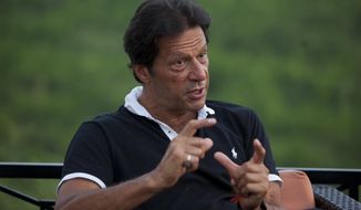 Pakistan's opposition leader Imran Khan speaks to the Associated Press at his residence in Islamabad, Pakistan, Monday, Sept. 25, 2017.  The cricketing legend who could potentially be Pakistan's future prime minister, Khan says the United States should stop trying to destroy the Taliban and instead should talk to them with help from Pakistan. (AP Photo/B.K. Bangash)