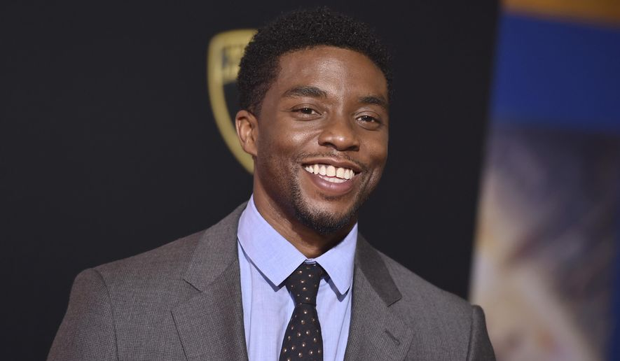 """FILE - In this Thursday, Oct. 20, 2016, file photo, Chadwick Boseman arrives at the Los Angeles premiere of """"Doctor Strange"""" at the TCL Chinese Theatre. Sterling K. Brown and Boseman are throwing their support behind pro football players who took a knee in protest of President Donald Trump. (Photo by Jordan Strauss/Invision/AP)"""