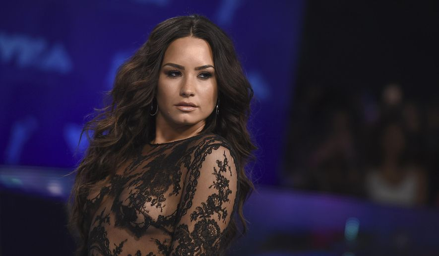 In this Aug. 27, 2017 ,file photo, Demi Lovato arrives at the MTV Video Music Awards at The Forum in Inglewood, Calif. Lovato was named a Global Citizen mental health ambassador Saturday at the organization's music festival in New York City's Central Park. (Photo by Jordan Strauss/Invision/AP, File)