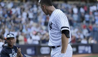 New York Yankees' Aaron Judge acknowledges the crowd after hitting a solo home run during the seventh inning of a baseball game against the Kansas City Royals at Yankee Stadium, Monday, Sept. 25, 2017, in New York. It was Judge's 50th home run, which sets a new record the most home runs hit by a rookie in the MLB. (AP Photo/Seth Wenig)