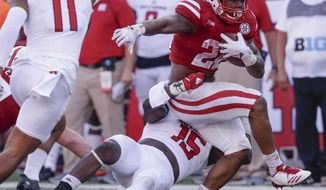 Nebraska running back Devine Ozigbo (22) is tackled by Rutgers linebacker Trevor Morris (15) during the second half of an NCAA college football game in Lincoln, Neb., Saturday, Sept. 23, 2017. Nebraska won 27-17. (AP Photo/Nati Harnik)