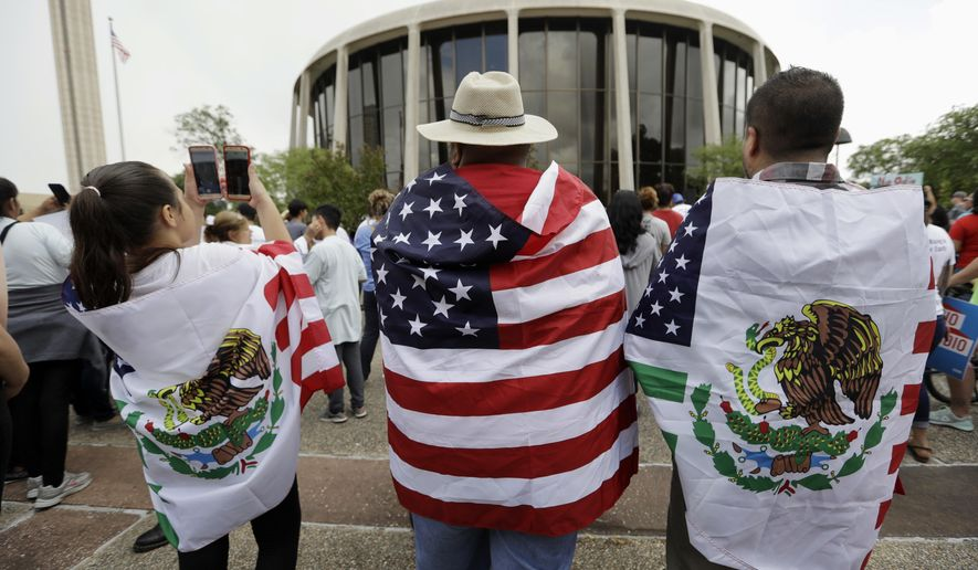 Protesters outside the federal courthouse in San Antonio, Texas, take part in a rally to oppose a new Texas sanctuary cities bill that aligns with the president's tougher stance on illegal immigration. A federal appeals court gave Texas more latitude Monday, Sept. 25, 2017, to enforce a sanctuary cities ban backed by the Trump administration, but opponents suing over the immigration crackdown said it was unlikely to drastically change the status quo. (AP Photo/Eric Gay) **FILE**