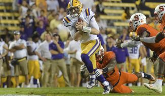 LSU quarterback Danny Etling runs the ball against Syracuse during an NCAA college football game Saturday, Sept. 23, 2017, in Baton Rouge, La. (Scott Clause/The Daily Advertiser via AP)