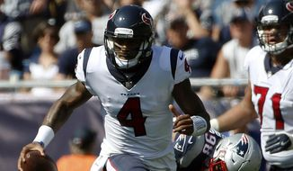Houston Texans quarterback Deshaun Watson (4) scrambles away from New England Patriots defensive end Trey Flowers (98) during the first half of an NFL football game, Sunday, Sept. 24, 2017, in Foxborough, Mass. (AP Photo/Michael Dwyer) **FILE**