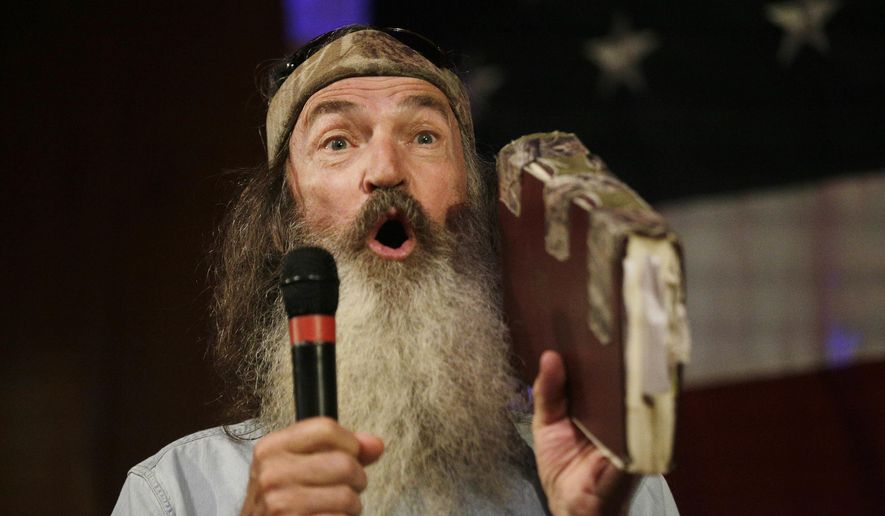 """Phil Robertson of """"Duck Dynasty"""" speaks at a rally for U.S. Senate hopeful Roy Moore, Monday, Sept. 25, 2017, in Fairhope, Ala. (AP Photo/Brynn Anderson) ** FILE **"""