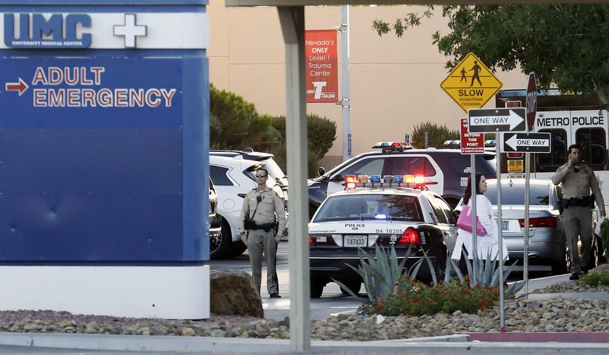 Las Vegas police work on the scene after an officer-involved shooting at University Medical Center on Monday, Sept. 25, 2017, in Las Vegas. Authorities say a man shot dead by a patrol officer was in police custody and under observation for intoxication when he obtained a stun gun and pointed it at a security guard and nurse. (Bizuayehu Tesfaye/Las Vegas Review-Journal via AP)